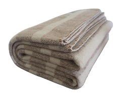 Cozy cream wool blanket for use on couch