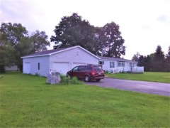 1.22Acres,3Bay heated Garage, Country but Min. to Everything