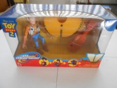 DISNEY PIXAR TOY STORY 2 MOVIN MORPHERS WOODY MORPHS INTO A WESTERN WAGON